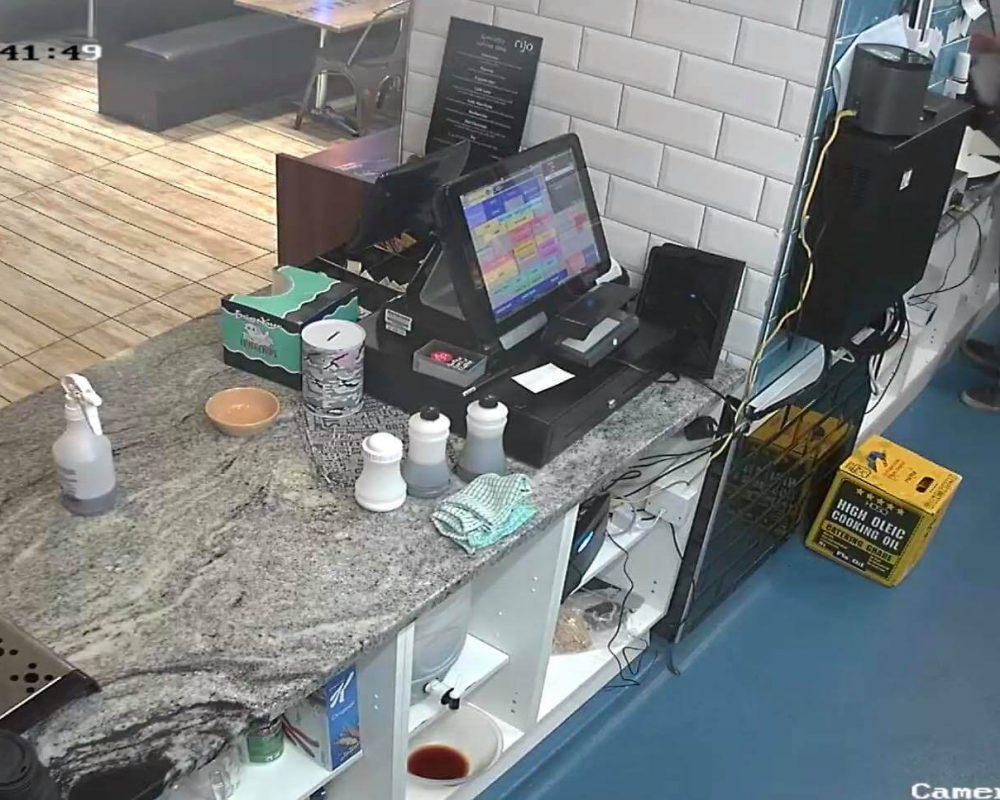 CCTV camera overlooking till area of restaurant